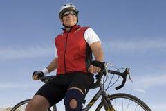 Senior Man Sitting On Bicycle Stock Image