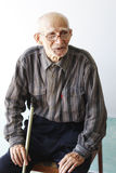Senior man sitting on chair Royalty Free Stock Photography