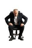 Senior man sitting on chair Stock Photo