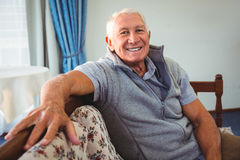 Senior man sitting on a couch Royalty Free Stock Photo
