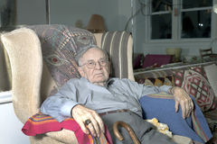 Senior man sitting on couch Royalty Free Stock Photo