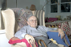Senior man sitting on couch Royalty Free Stock Images