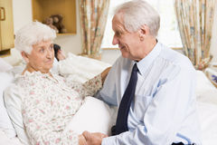Senior Man Sitting With His Wife In Hospital royalty free stock image