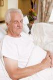 Senior Man Sitting In Hospital Bed Royalty Free Stock Photos