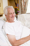Senior Man Sitting In Hospital Bed Royalty Free Stock Photography