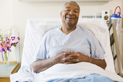 Senior Man Sitting In Hospital Bed Royalty Free Stock Image