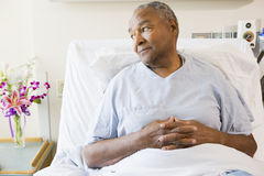 Senior Man Sitting In Hospital Bed Royalty Free Stock Images