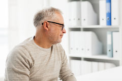 Senior man sitting  at medical office Stock Images