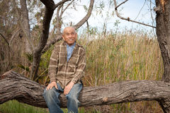Senior Man Sitting On A Tree In A Park Royalty Free Stock Photo