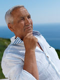 Senior man sitting outside Royalty Free Stock Photo