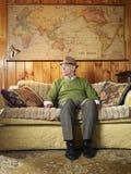 Senior Man Sitting On Sofa Stock Photo
