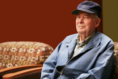 Senior man sitting in waiting room Royalty Free Stock Images