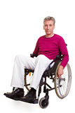 Senior man sitting in wheelchair Stock Image