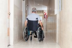Senior Man Sitting In a Wheelchair Royalty Free Stock Photos