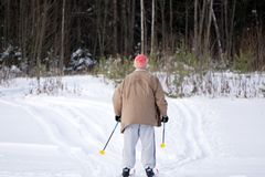 Senior man with skis in the snow . royalty free stock photography