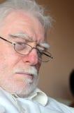 Senior man sleeping. Asleep senior man wearing glasses Stock Image