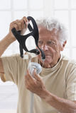 Senior Man with sleeping apnea machine Stock Photo
