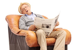 Senior man sleeping on an armchair Royalty Free Stock Photo