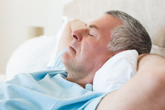 Senior man sleeping in bed Royalty Free Stock Photos