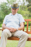 Senior man sleeping on bench at park Royalty Free Stock Images