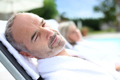 Senior man sleeping in long chair Royalty Free Stock Images