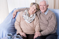 Senior man and sleeping wife Royalty Free Stock Photos