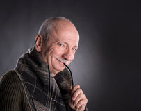 Senior man with a sly expression Royalty Free Stock Photography