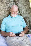Senior Man with Smart Phone Royalty Free Stock Photos
