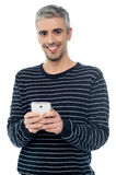 Senior man on smart phone Stock Photos