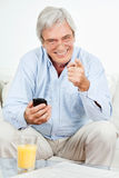 Senior man with smartphone Royalty Free Stock Image