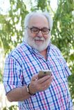 Senior man with a smartphone Royalty Free Stock Image