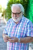 Senior man with a smartphone Royalty Free Stock Photo