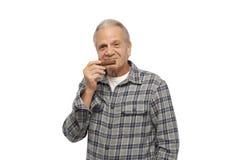 Senior man smelling cigar Royalty Free Stock Photography