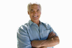 Senior man smiling with arms folded, cut out stock images