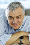 Senior man smiling looking at camera royalty free stock image