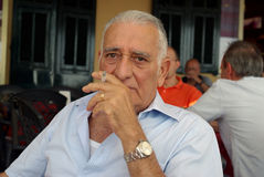 Senior man smoking Stock Images