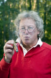 Senior man smoking big cigar Stock Photography