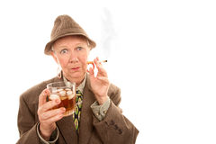 Senior man smoking cigarette Stock Image