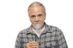 Senior man smoking Electronic Vapor Cigarette Royalty Free Stock Images