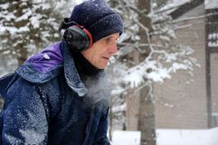 Senior man snow blowing Royalty Free Stock Image