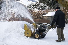 Senior man with snowblower Royalty Free Stock Image