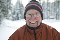 Senior man in snowy winter scene royalty free stock photo