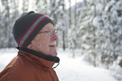 Senior man in snowy winter scene Royalty Free Stock Photography
