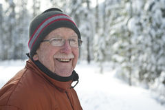 Senior man in snowy winter scene Royalty Free Stock Image