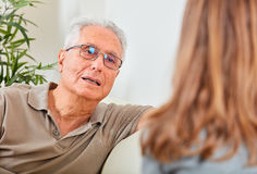 Senior man with social worker. Old aged senior men talking with social worker women at home Royalty Free Stock Photography