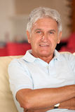 Senior man in sofa Stock Images