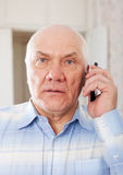 Senior man speaking by mobile Royalty Free Stock Photography