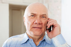 Senior man speaking by mobile Stock Photo