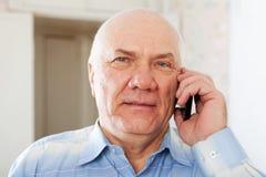 Senior man speaking by mobile Stock Photo