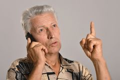 Senior man speaking on telephone Stock Image